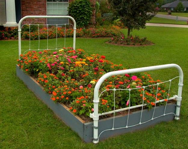 An Old Iron Bed Frame Makes A Wonderful Garden Accent At Their