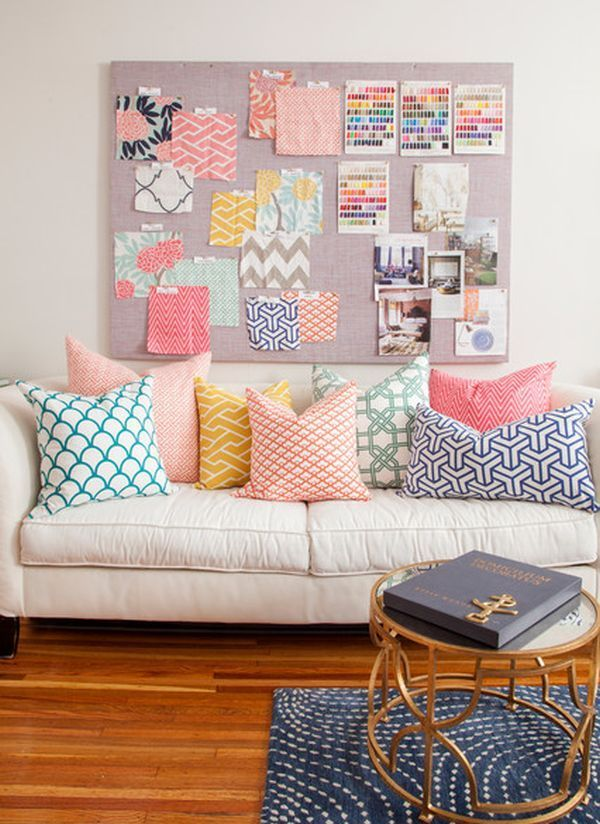 a simple and forever stylish combination white sofa and colorful pillows