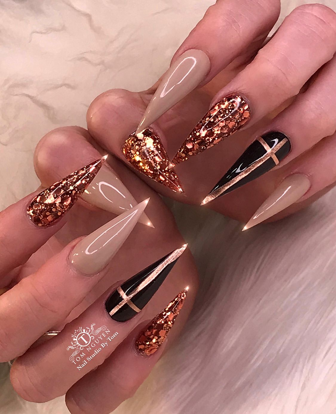 b56ed218950 Bling bling nails. Stiletto acrylic manicure with taupe, gold glitter and  black with gold