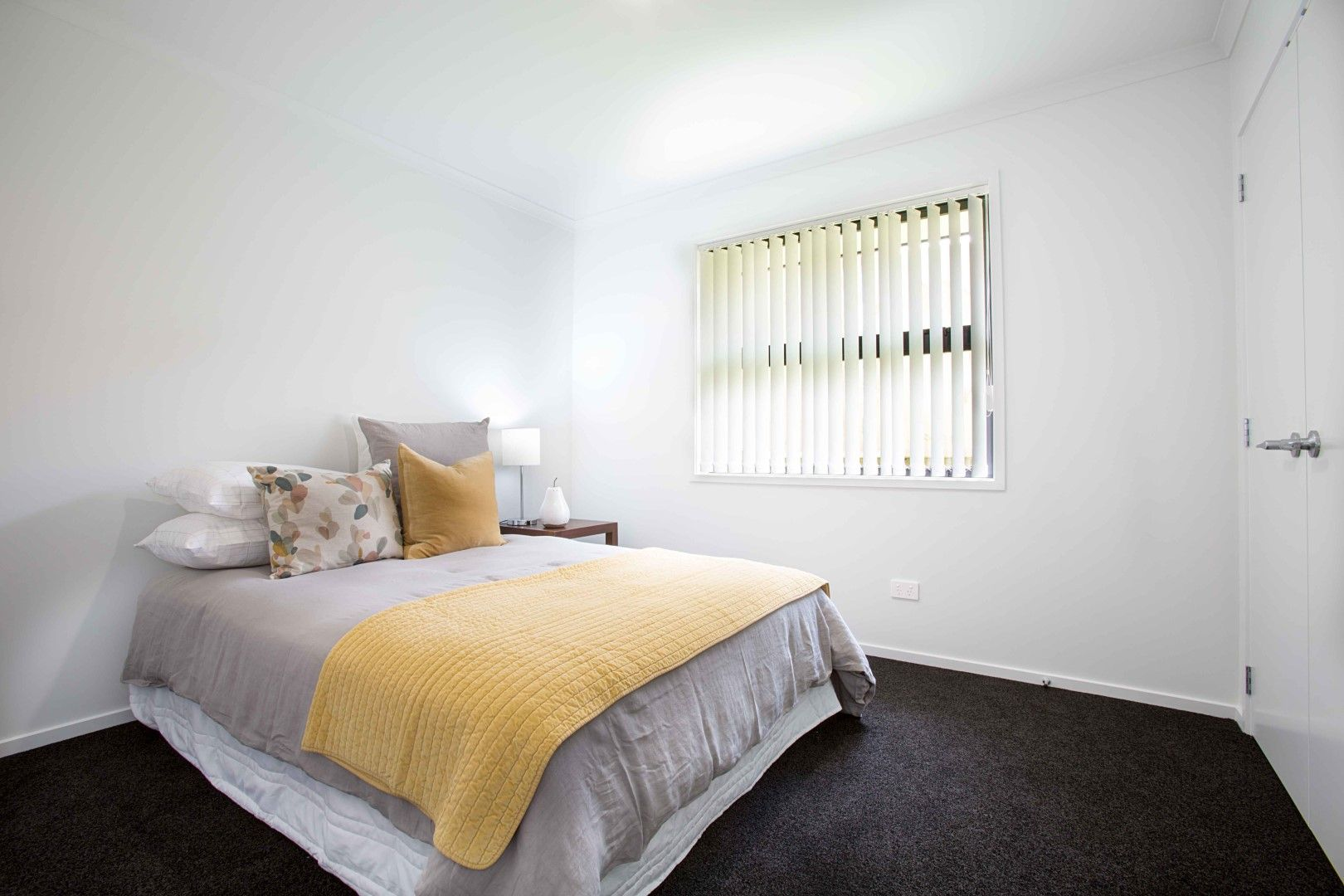 Large double bedroom soft grey duvet and mustard yellow