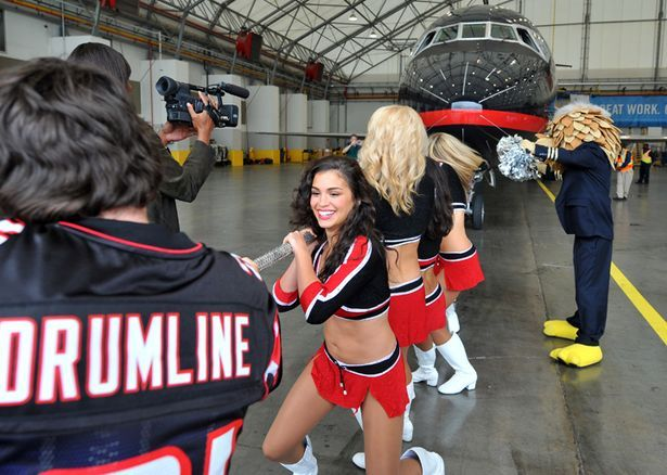 Falcons Sponsorship/Charity Event:To raise money for breast cancer awareness month, members of the Falcons cheerleader and drum line pulled the 100,000 pound plane out of the hanger for charity. AirTran made a $10,000 donation to the charity Breast Friends Inc. for their effort.