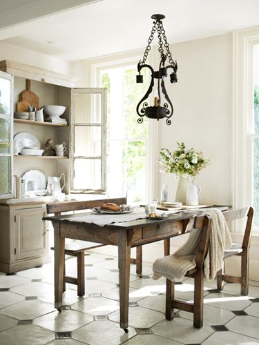 Love the pairing of this vintage oak florist's table with weathered oak benches in this breakfast nook. #white #antiques #decoratingideas
