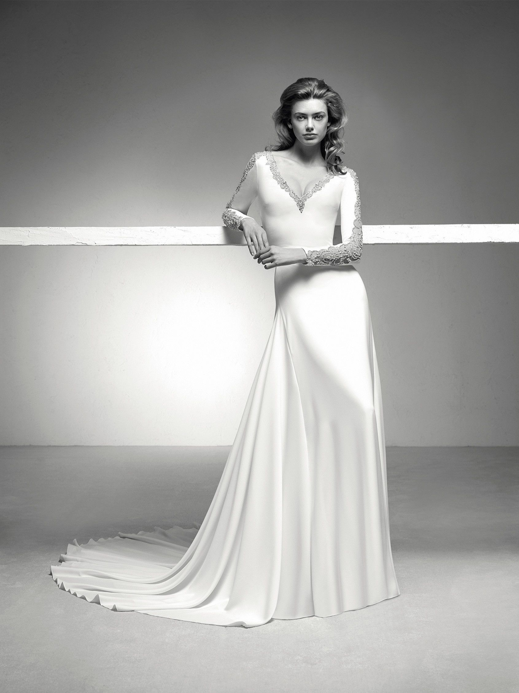 Icaria fabulous wedding dress with a flared skirt in crepe with an
