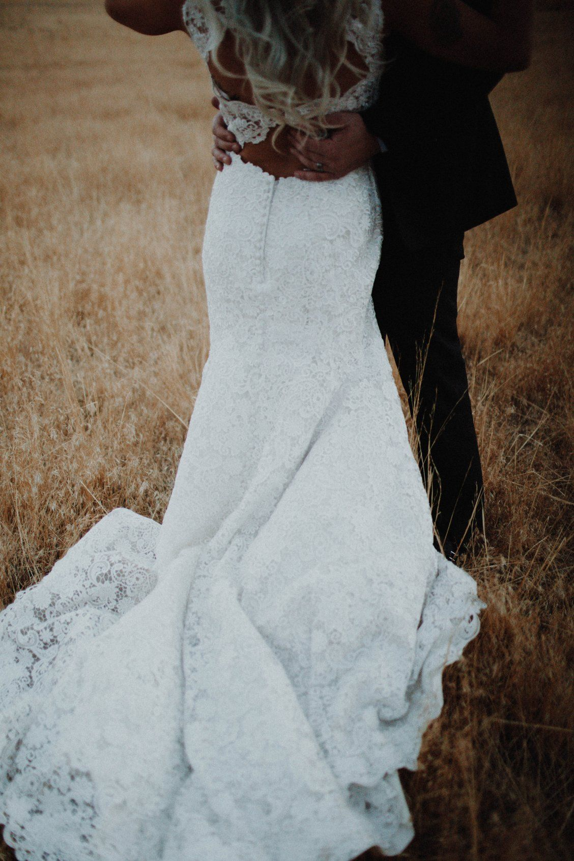 Romantic lace wedding dress in bohochic styled shoot at dusk