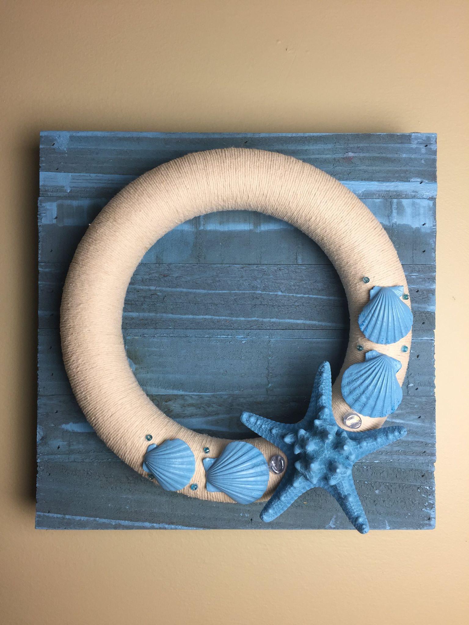 Beach theme twine wearth on aged wood. https://www.facebook.com/photo.php?fbid=10154254664478496
