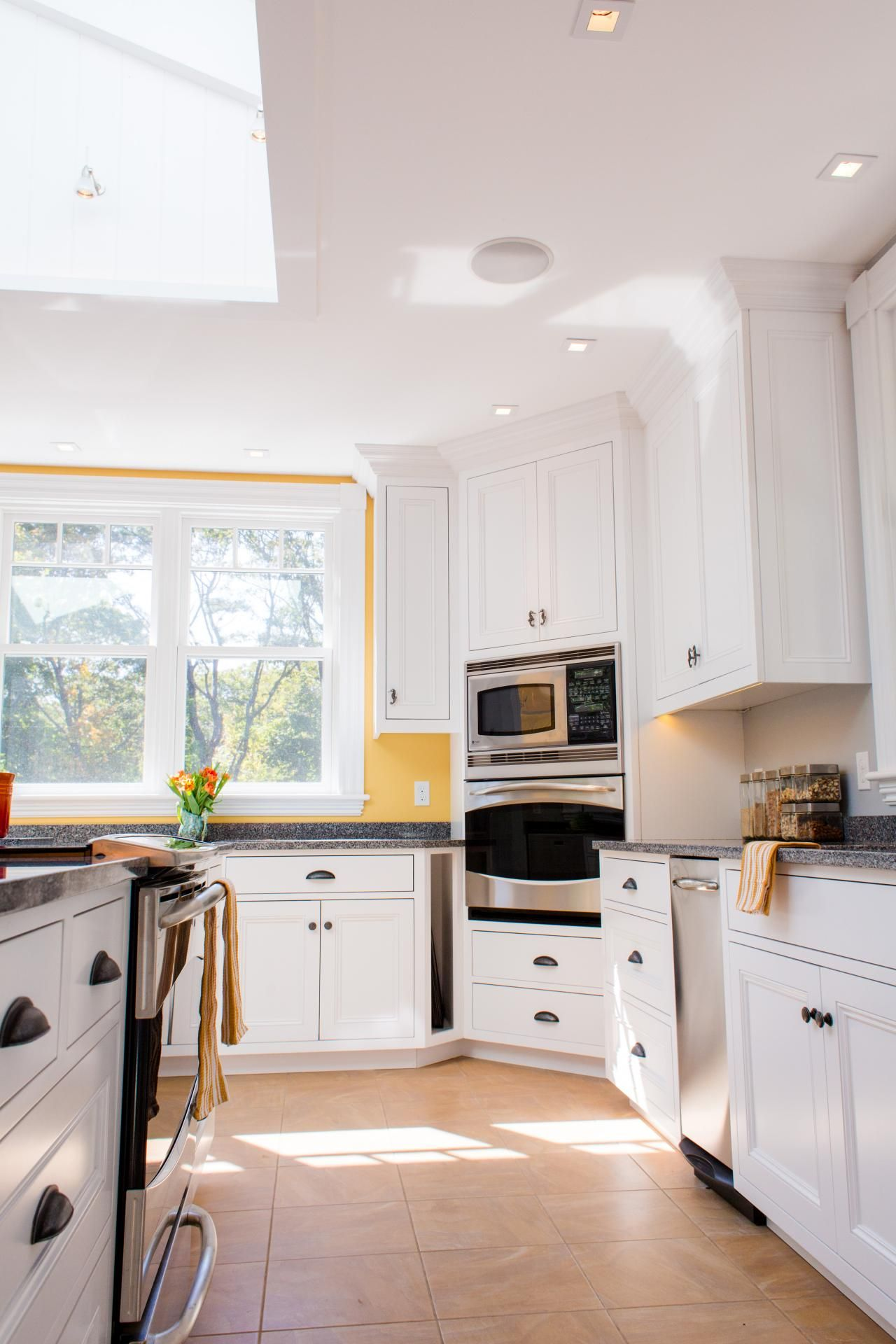 Fresh white cabinets pair beautifully with the bright yellow walls