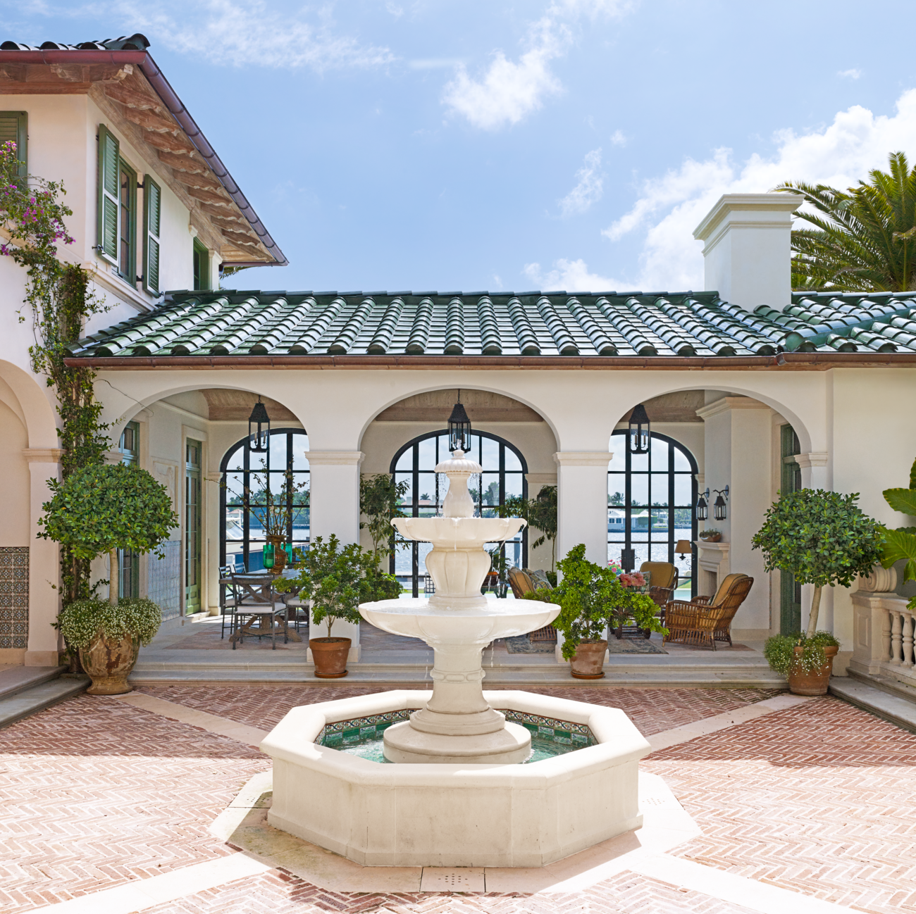See Inside Designer Betsy Shiverick S Breezy Palm Beach Home Is Picture Perfect Spanish Style Homes Patio Spanish Style