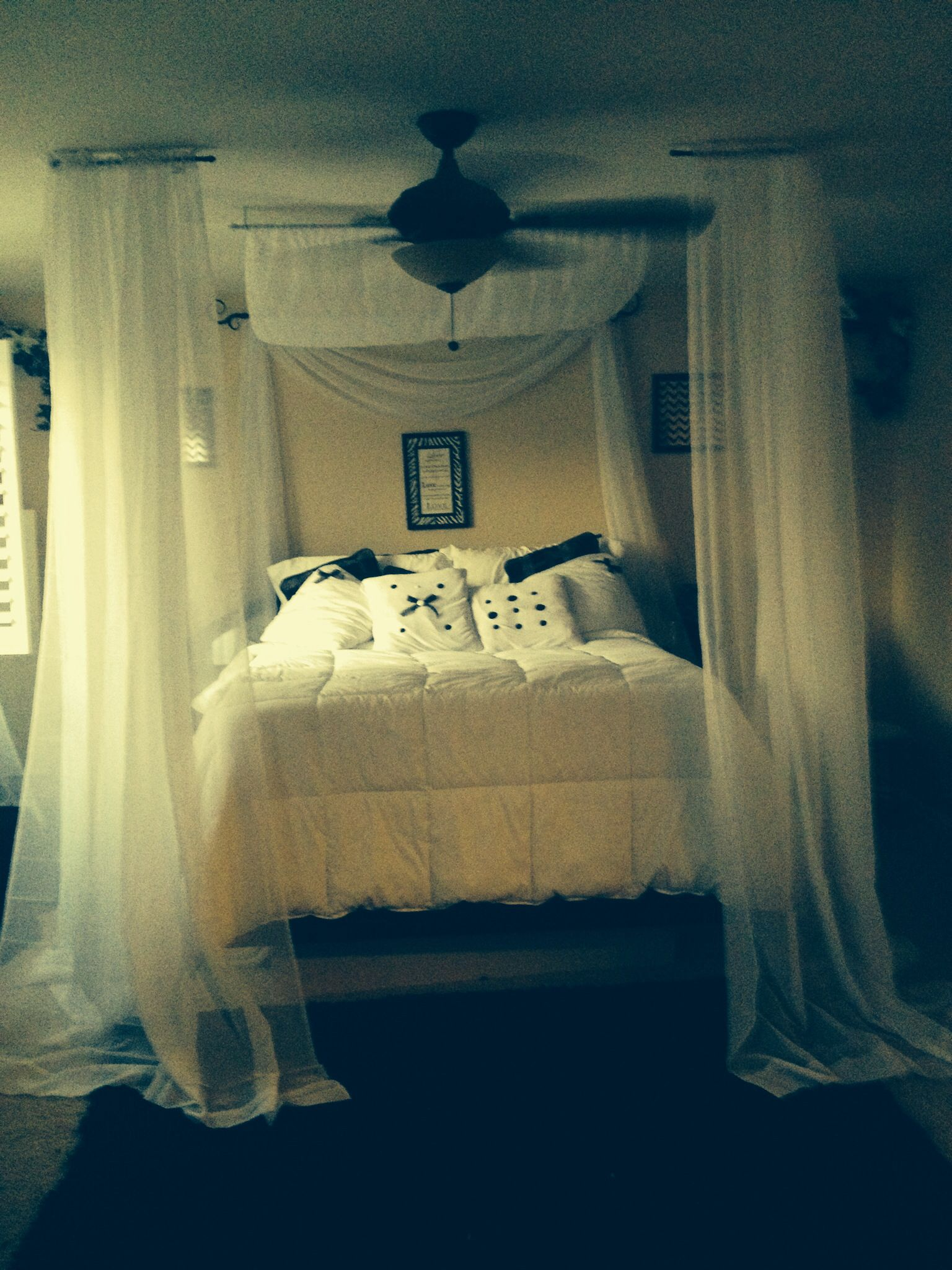 My diy canopy bed with curtain rods