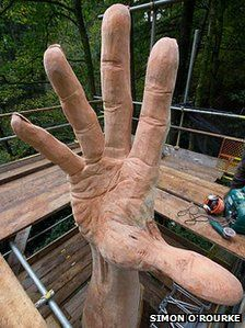 """The remnants of the UK's tallest tree, which was felled after being damaged in a storm, has been transformed into a carving of a giant hand... """"It's a last attempt by the tree to reach the sky."""""""