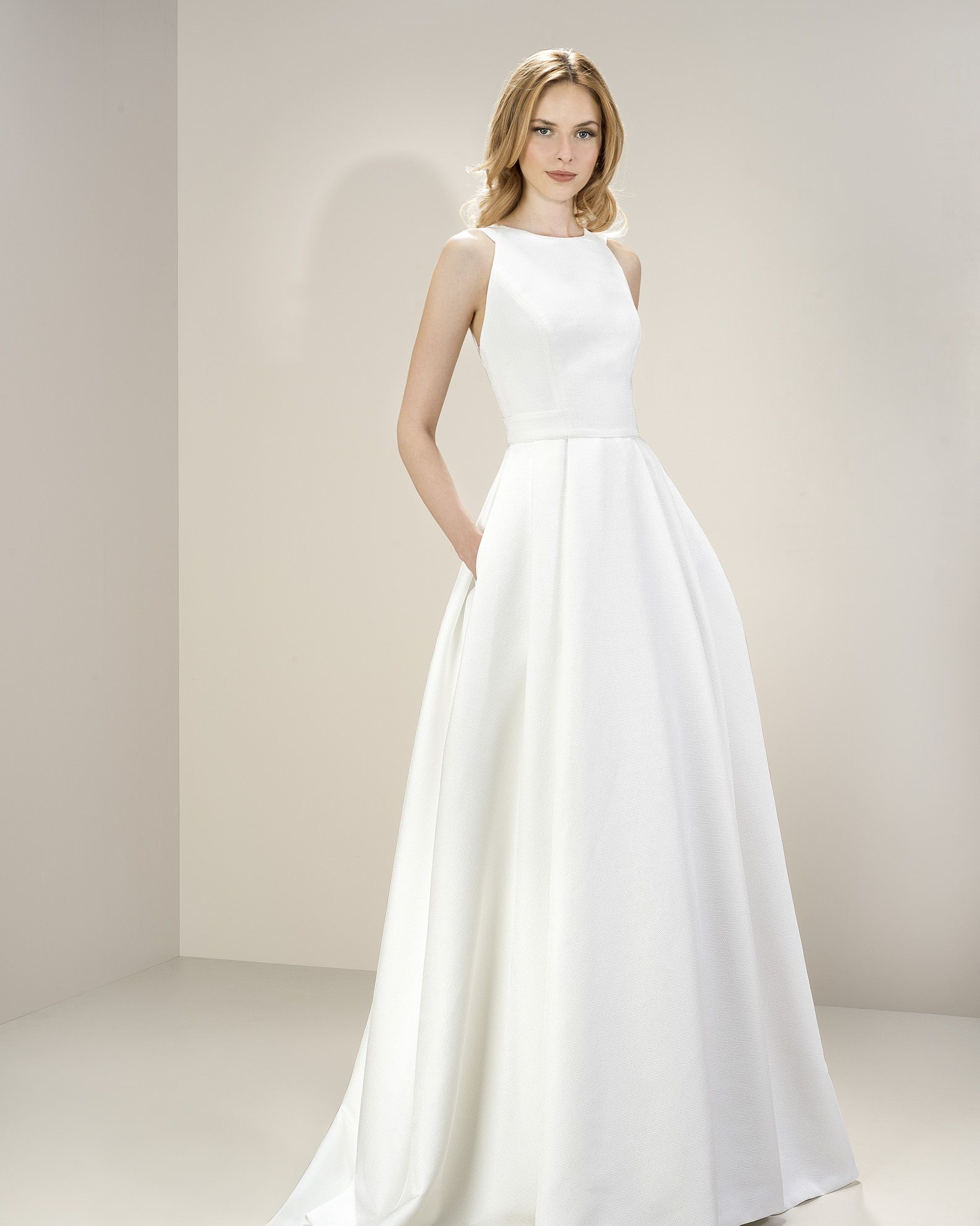 METROPOLIS Collection by JESUS PEIRO. Now at Southern Protocol Bridal.  Visit www.southernprotocol.com to make your appointment! 821b3f4adf27