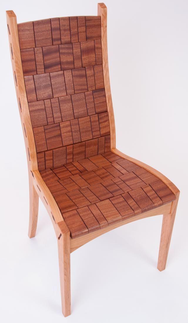 Side chair of Cherry frame and mahogany blocks. Alain Daigre