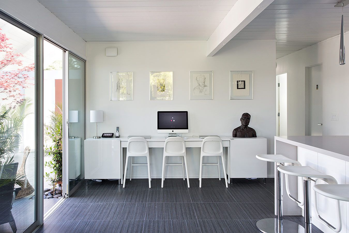 This triple seated home office area is a great addition for a modern