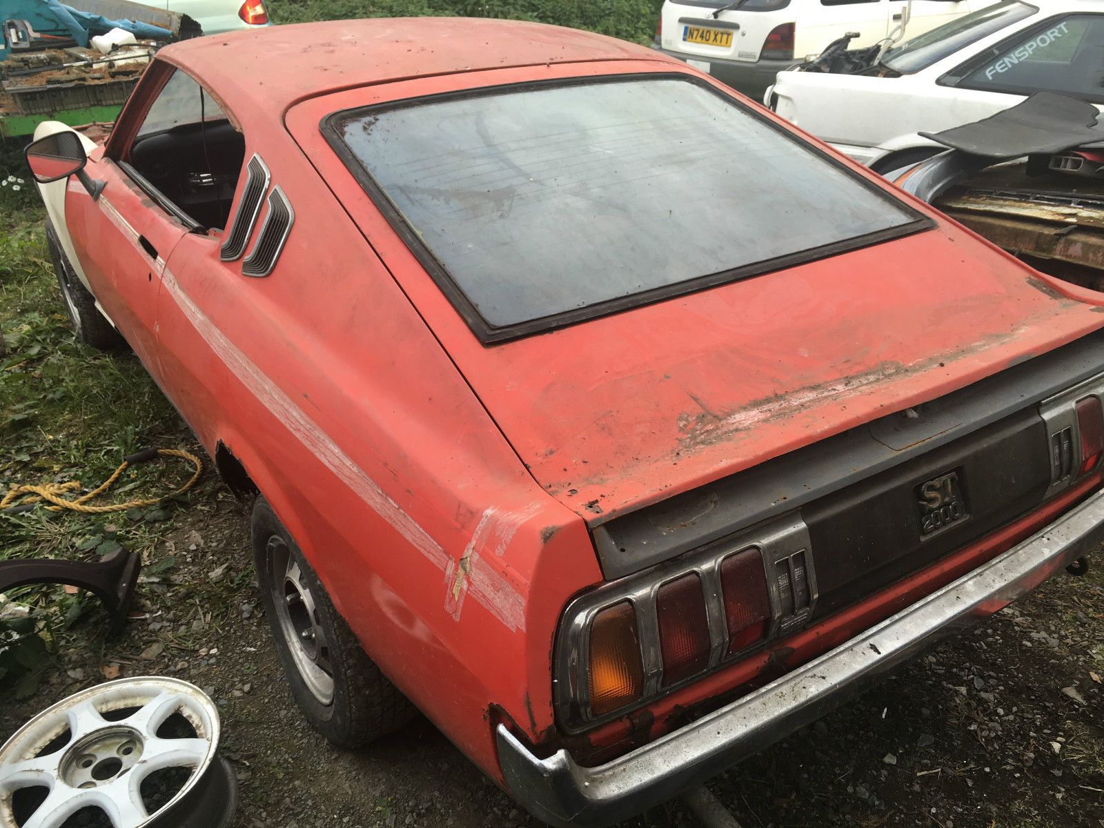 1976 toyota celica ra28 st lift back mustang red restoration project