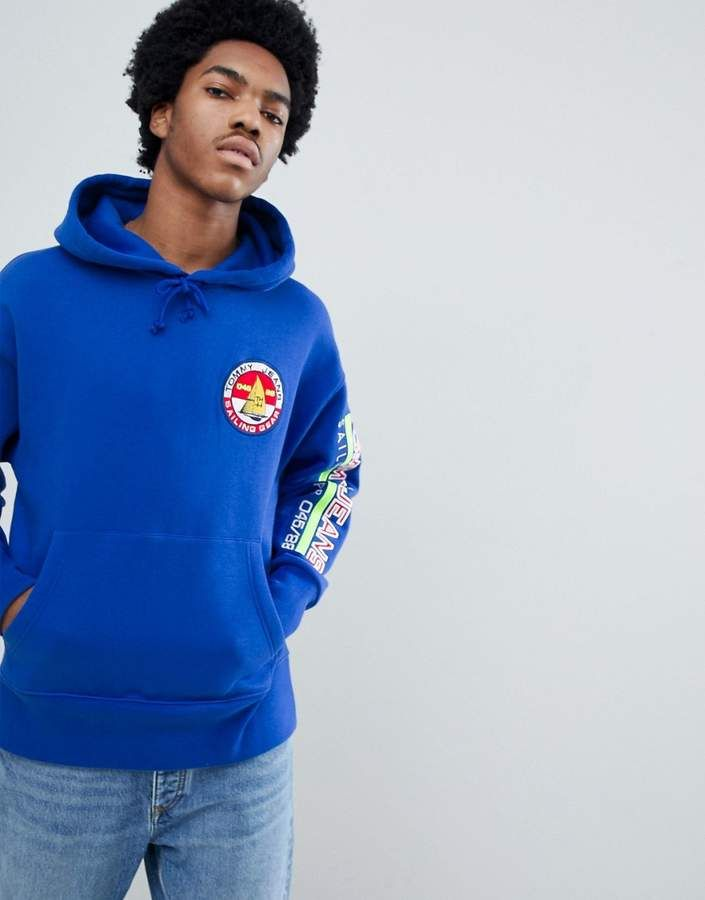 3035770a596b Tommy Jeans 90s Sailing Capsule Back and Sleeve Logo Hoodie in Bright Blue