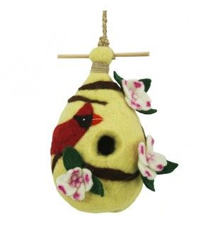 Dogwood & Cardinal Felt Birdhouse is handmade by skilled artisans working in a fair trade production center in Kathmandu, Nepal. Small birds like wrens, chickadees, nuthatches and titmice might nest in it, or they might pull at the wool to use in making their own nests. It's made of 100% naturally water-repellent wool, which is also naturally dirt- and mold-resistant. Use it as a door greeter, a porch ornament, or even to enliven a kitchen, bath or bedroom!
