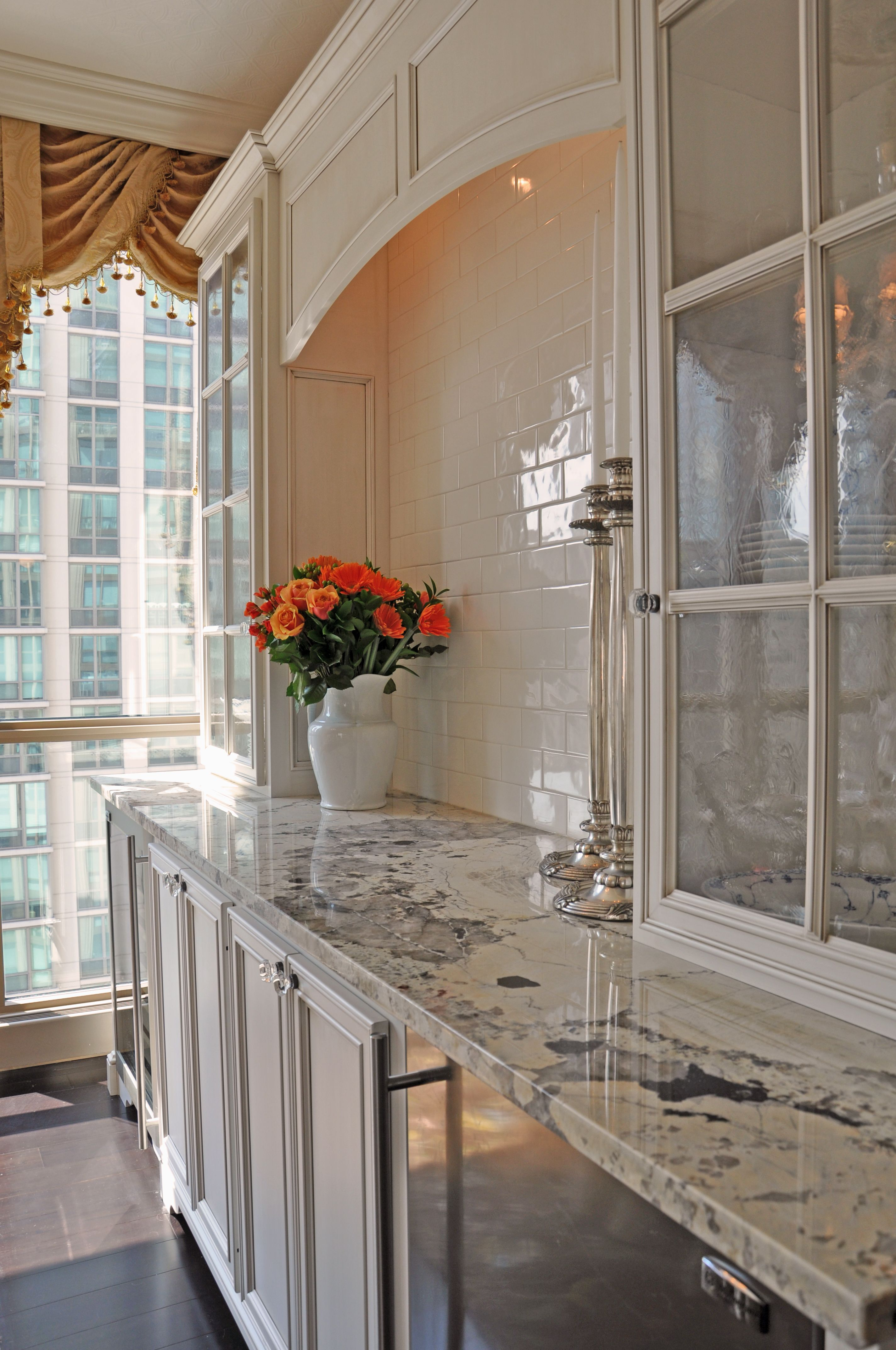 Custom built dining room buffet with wine fridge and under