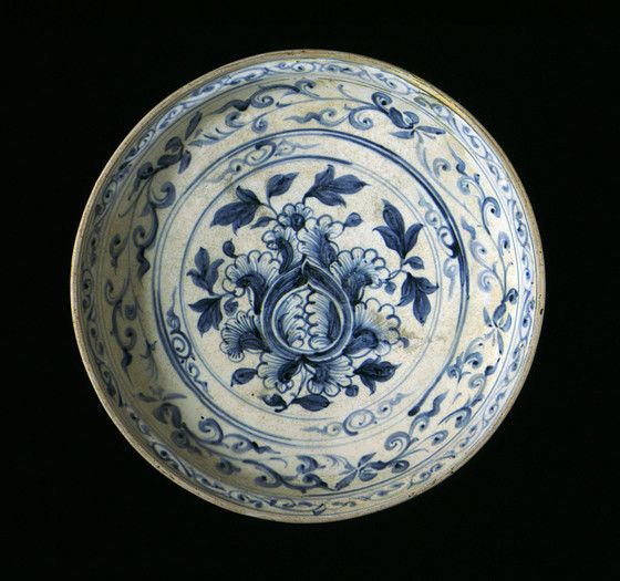 Dish with Peony Spray and Floral Scrolls, Vietnam, 1450-1550. Wheel-thrown stoneware with cream slip, underglaze blue painted decoration, and clear glaze. Height: 3 1/8 in. (7.94 cm); Diameter: 14 1/8 in. (35.88 cm). Los Angeles County Museum of Art, Gift of Ambassador and Mrs. Edward E. Masters (M.84.213.235). Photo © Museum Associates/LACMA