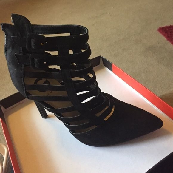 Black caged booties Size 9 used a couple of times in good condition still. Comes in the box. Material is suede like G by Guess Shoes Ankle Boots & Booties