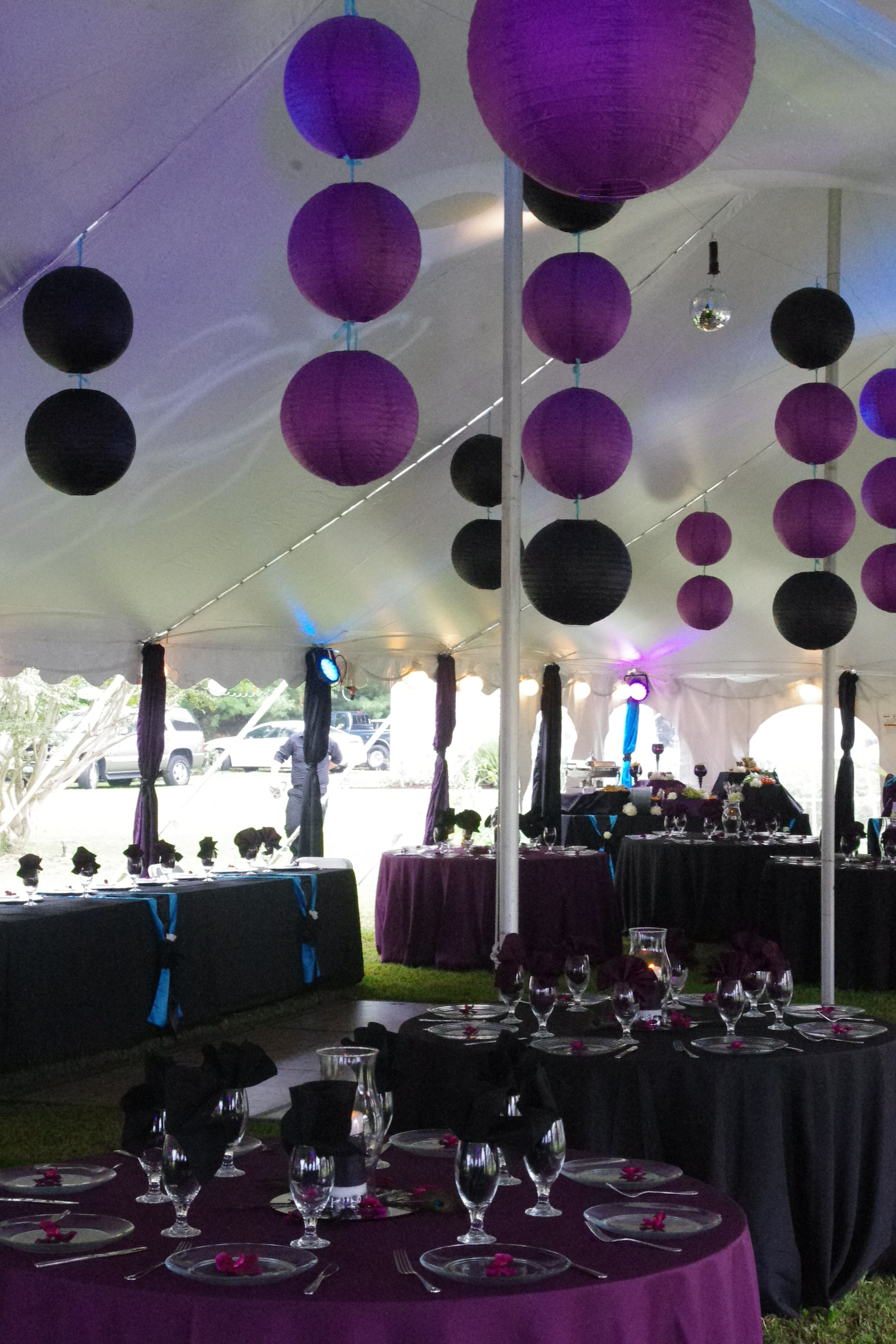 Cute purple and black lanterns used as party decor ...