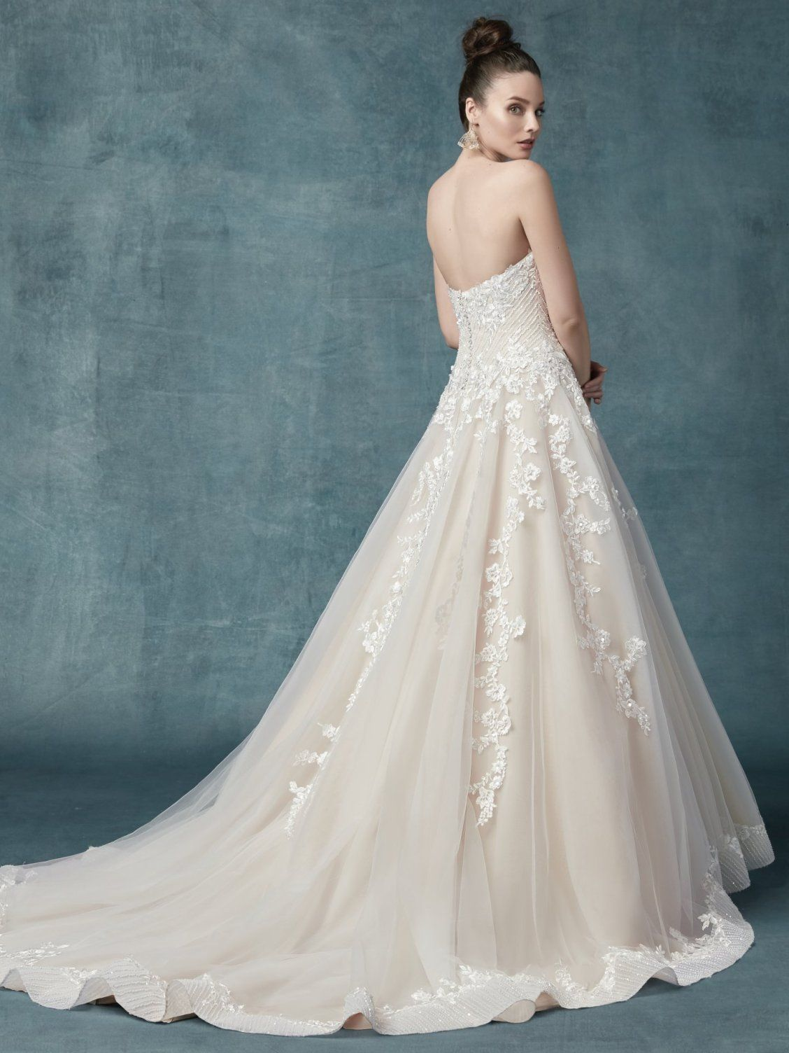 a1592875707 ... Floral lace motifs dance over tulle in this unique princess ballgown