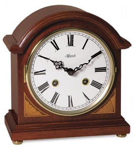 """22857-N90130 - Hermle Liberty Barrister style mantel clock in cherry finish with corner inlays. Mechanical strike movement, 8-day power reserve, 1/2 hour strike.  Measures: H 8-1/2"""" x W 7-1/2"""" x D 4-1/2""""   Three year manufacturer's warranty    Free shipping from http://www.theisenclock.com/mantel_clock.html"""