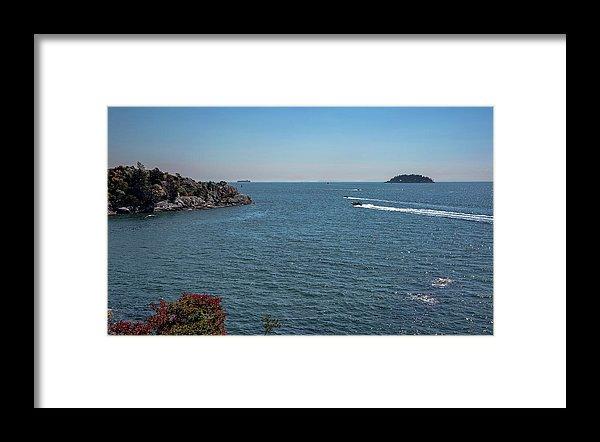 Alex Lyubar Framed Print featuring the photograph Rocky Beach In Burrard Inlet by Alex Lyubar #AlexLyubarFineArtPhotography #VancouverCanada #SeaScape#WhyteCliffPark#BlueWater#BlueSky#RockyIslands#MotorBoats#Speed #ArtForHome#HomeDecor#ArtPrintForSale