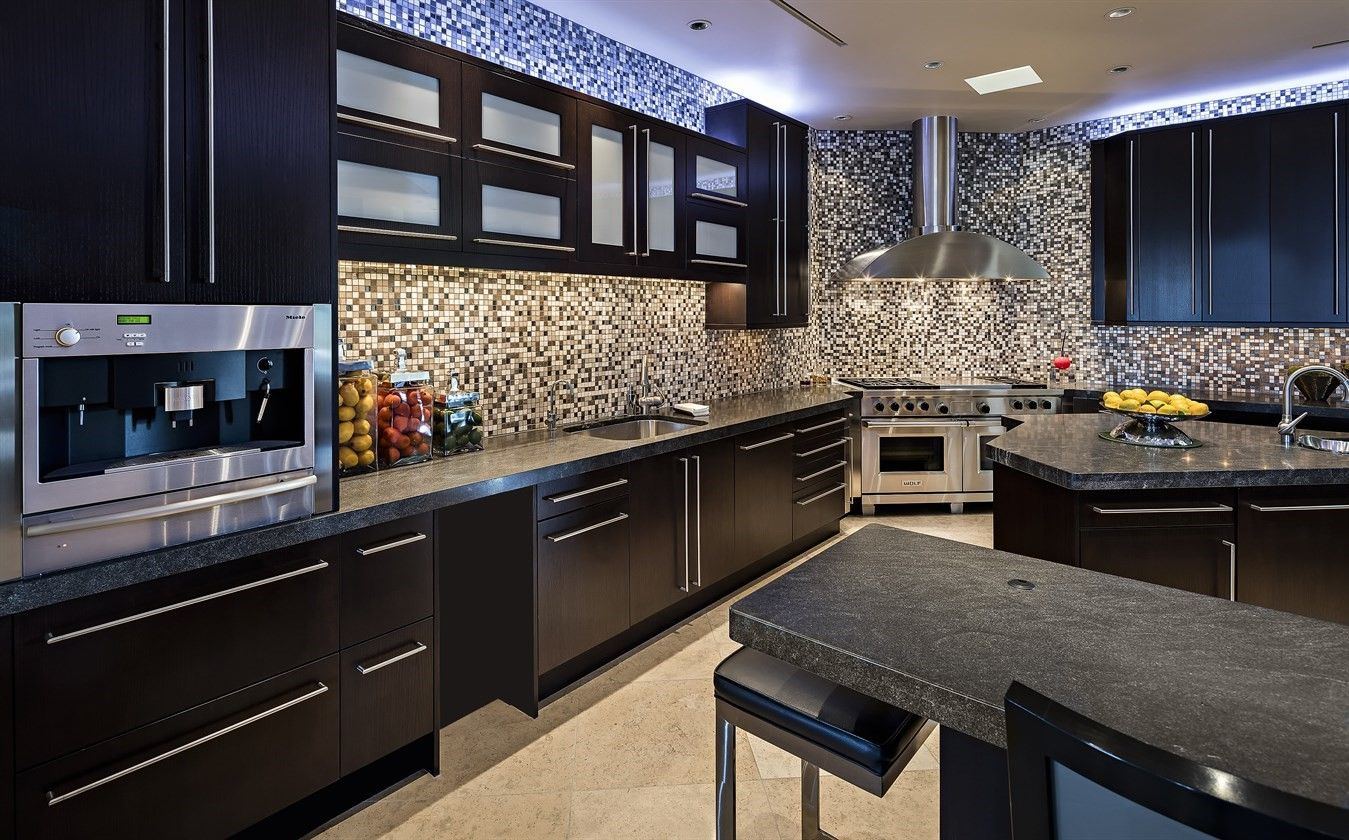 Modern Kitchen With Top Of The Line Appliances Including A Built In Espresso Machine Solid Wood Kitchen Cabinets Best Kitchen Designs Kitchen Design