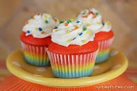 Colorburst Cupcakes    1 white cake mix  2 eggs  1 C yogurt (any smooth textured fruit flavor is fine!) or sour cream  1/2 C milk  1/3 C vegetable oil    Combine all ingredients until incorporated (about 30 seconds). Scrape sides of bowl and then beat on med-high speed for 2 minutes.    Divide batter according to how many colors you are using.  Bake them according to the package directions, until a toothpick comes out dry.  from our best bites.com