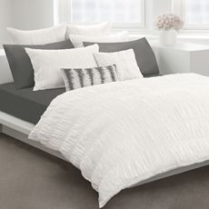 White duvet cover and gray sheets