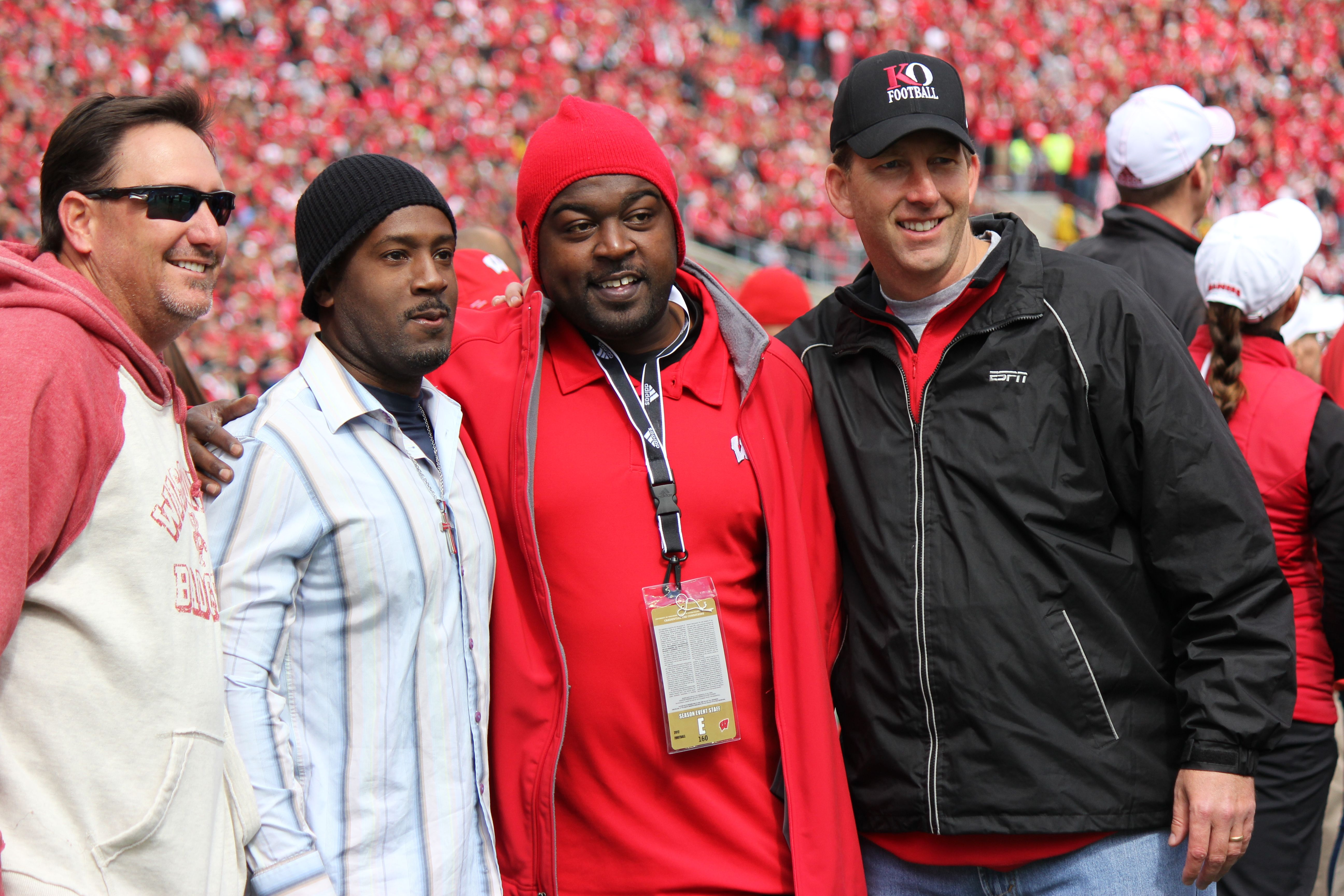 Heisman Trophy winner Ron Dayne takes photos with fans.