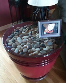 Cheap and awesome....I can never find end tables I like, but I LOVE river rock.  You can use anything, though, really.  Wine corks, sand, shells...endless possibilities!