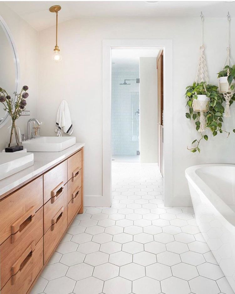 Master? Hexagon floor. Natural oak cabinets. White walls ...
