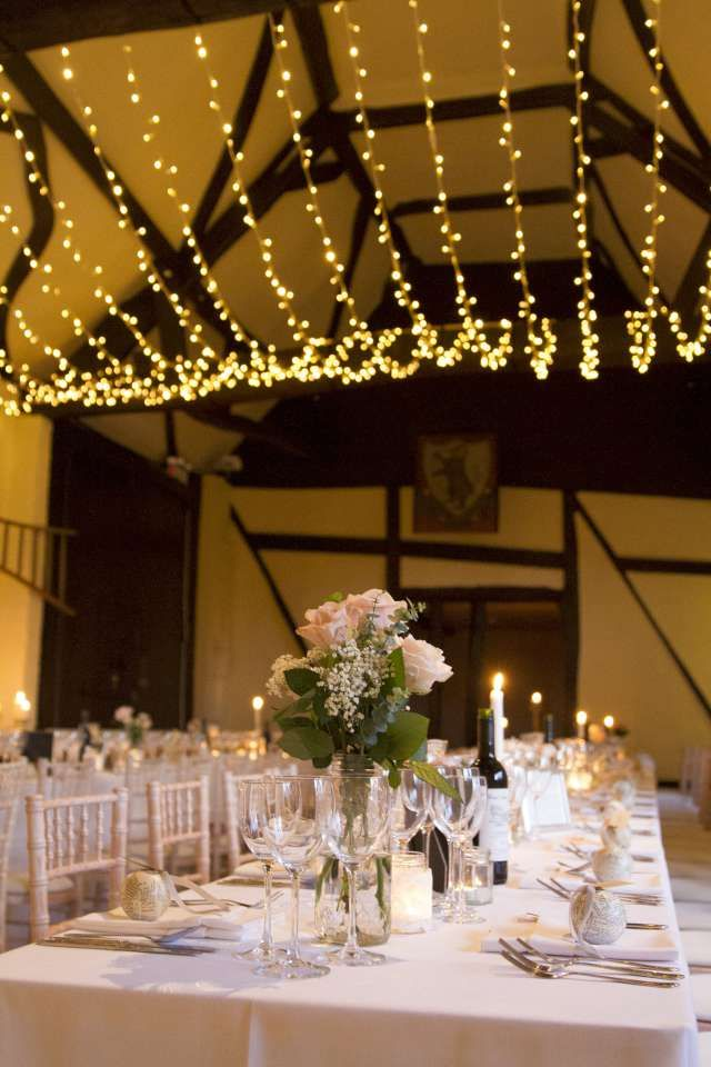 lovely warm white light canopy for a barn wedding barn wedding lights