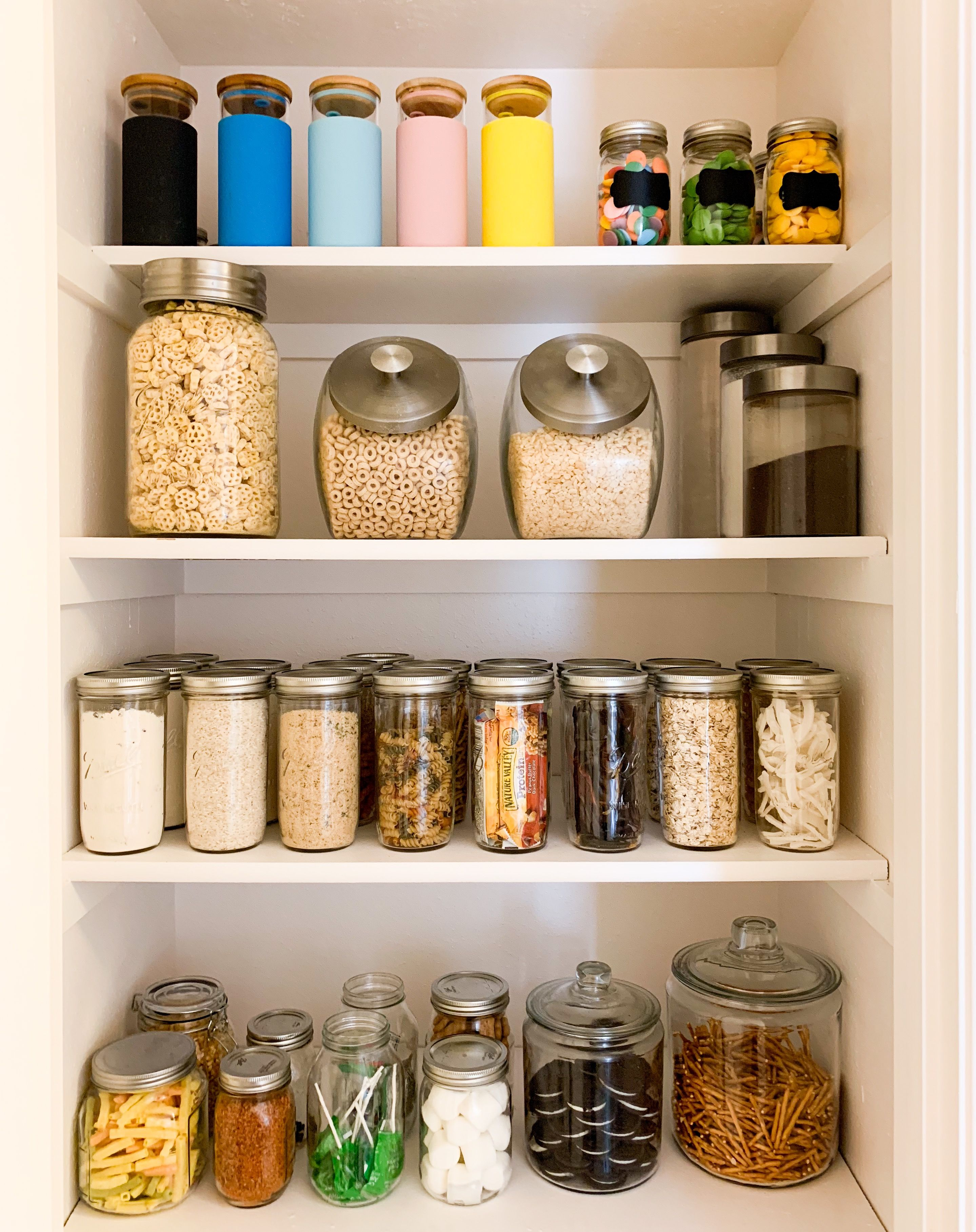 Organized Pantry With Mason Jars And Baskets Fruits Veggies
