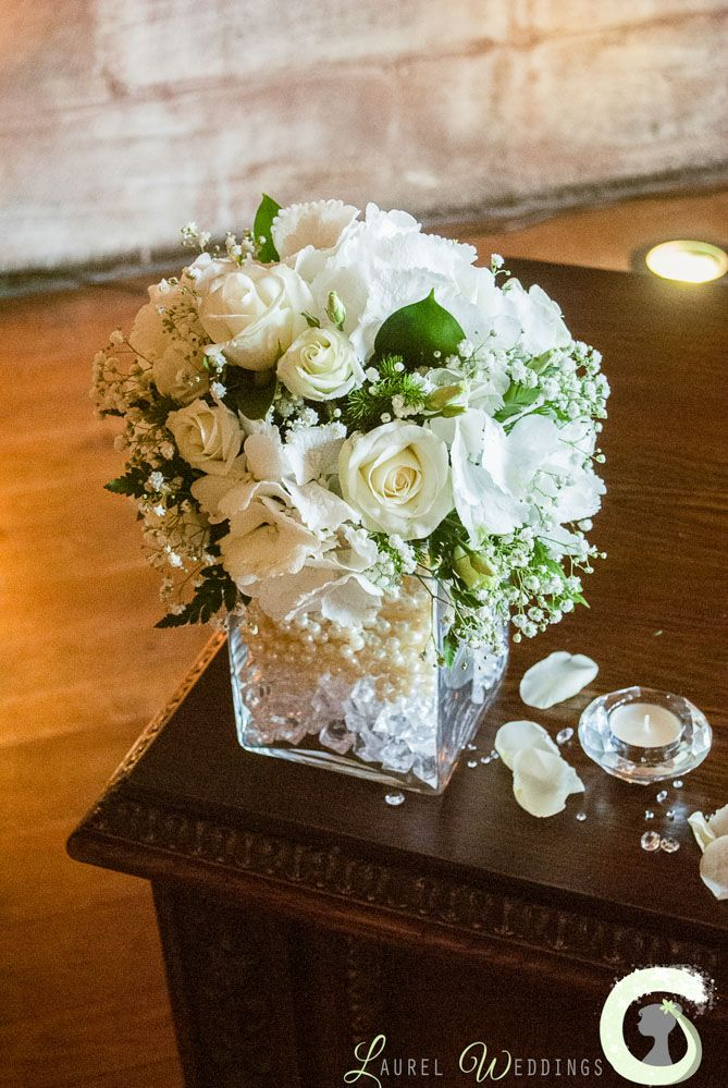 ceremony table arrangement of roses  hydrangea and gypsophila