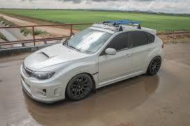 White Subaru Sti Hatchback With Roof Racks Subaru Hatchback Subaru Wrx 2011 Subaru Wrx