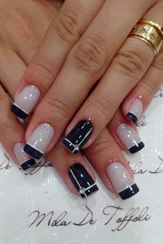 Pale Shimmery Grey Nude With Black And White French Tips Base Cross Rhinestone Detail On Accent Nails