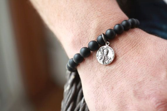 David Yurman Style Bracelet with Coin Accent ..On the coin is Saint Benedict Stunning 10 MM Gemstone Bracelet with a Silver Accent! Hot Celebrity trends