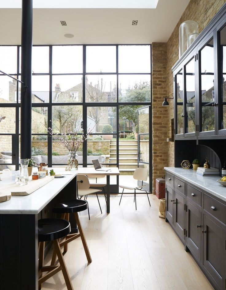 10 Beautiful Rooms - Mad About The House And on that note, I leave you with this kitchen below which incorporates a few of my favourite things: no, not raindrops on roses but worktops in marble and black painted windows, dark coloured wall lights and glass fronted cupboards, brick walls and floorboards and black steel columns, these are a few of my favourite things.