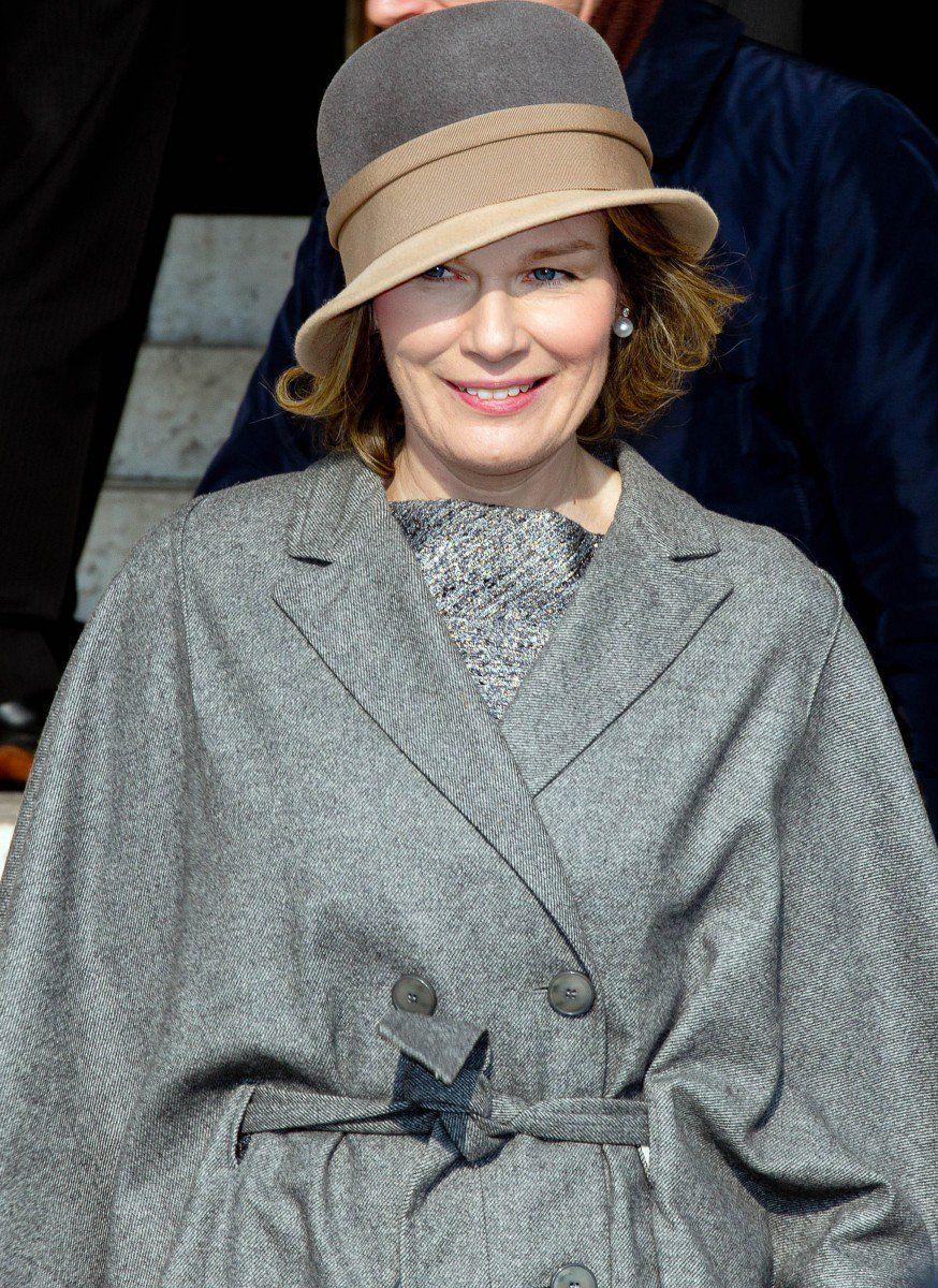 Queen Mathilde looked very chic in her belted cape coat.