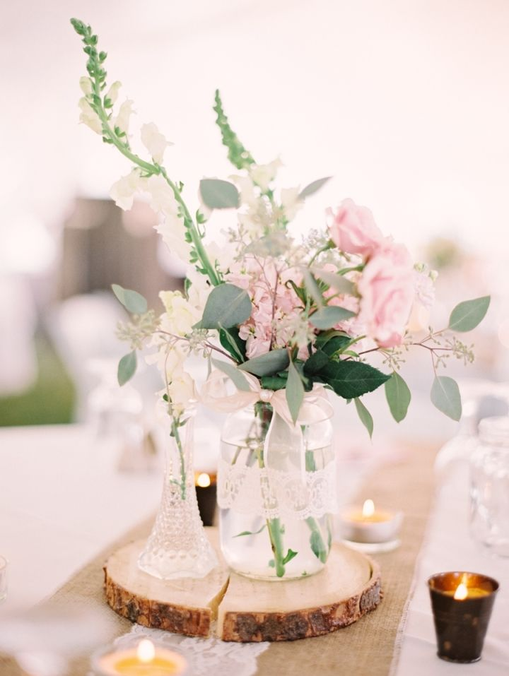 Blush toned | blush flowers + green filled in mason jar + burlap + candles as wedding centrepiece #chicwedding #rusticchic #rusticelegance #rusticwedding #weddingcenterpieces