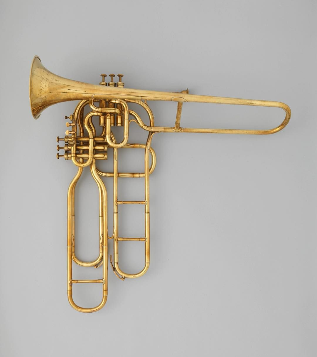 "metmuseumAdolphe Sax was born on this day in 1814. ""Celebrating Sax: Instruments and Innovation,"" on view through January 3, features twenty-six instruments made by three generations of the Sax family and marks the bicentenary of the birth of Adolphe Sax. Adolphe (Antoine Joseph) Sax (Belgian, 1814–1894). Tenor valve trombone, ca. 1863. #metmuseum #AdolpheSax #MetMusic"