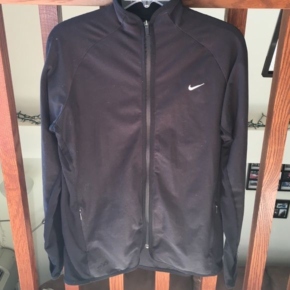 Nike Dry-Fit Full Zip Jacket Dry-Fit material. Full length front zipper. Has a zipper pocket on each side as well as thumb holes at the end of each sleeve. Great for layering or working out! Slightly worn and great shape! Nike Jackets & Coats