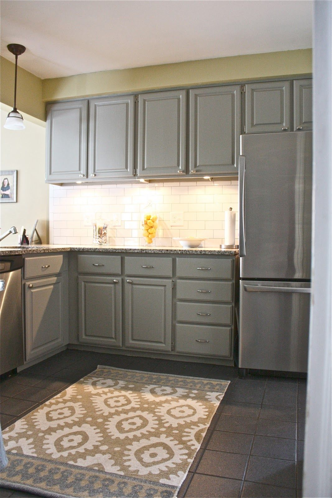kitchen make over - love the grey cabinets and white subway tile