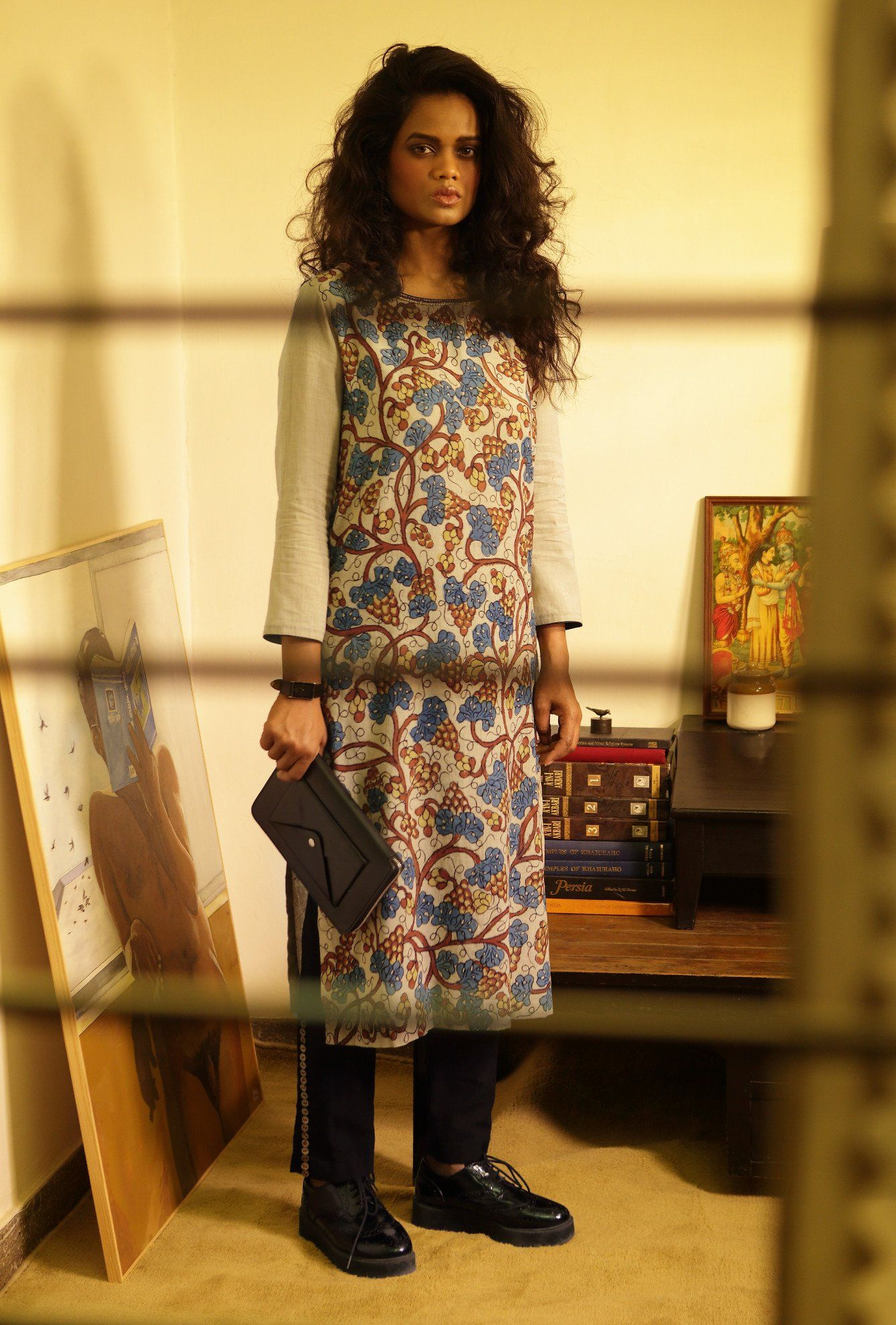 Tunic in khadi malmal cotton, with kalamkari hand painting. Ankle length cigarette pants in khadi cotton Fabric Tunic: Khadi malmal cotton Fabric Pants: Khadi Cotton Care: Dry Clean Only SHIPPING & RETURNS This product qualifies for free shipping
