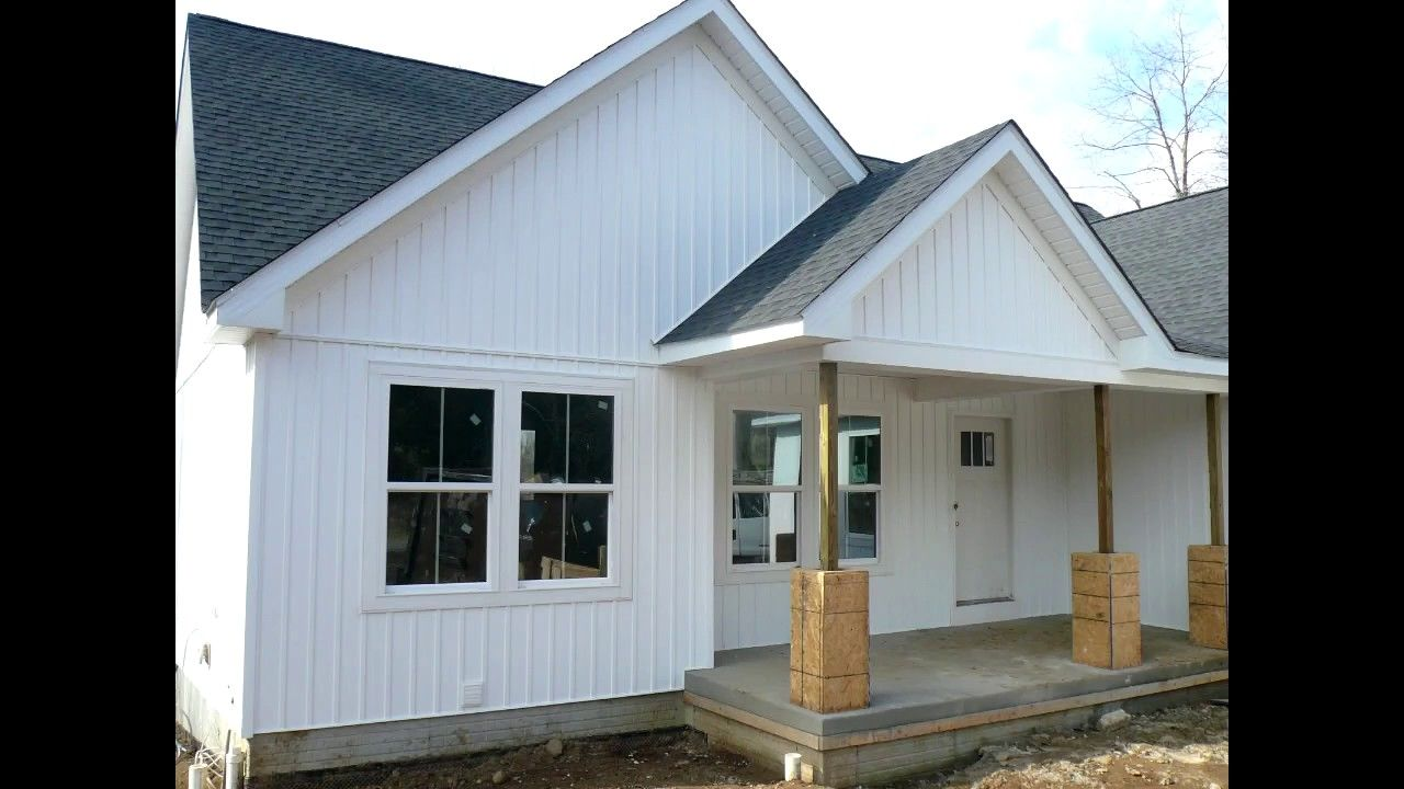 Charming Exterior With White Vertical Board And Batten Siding Wall