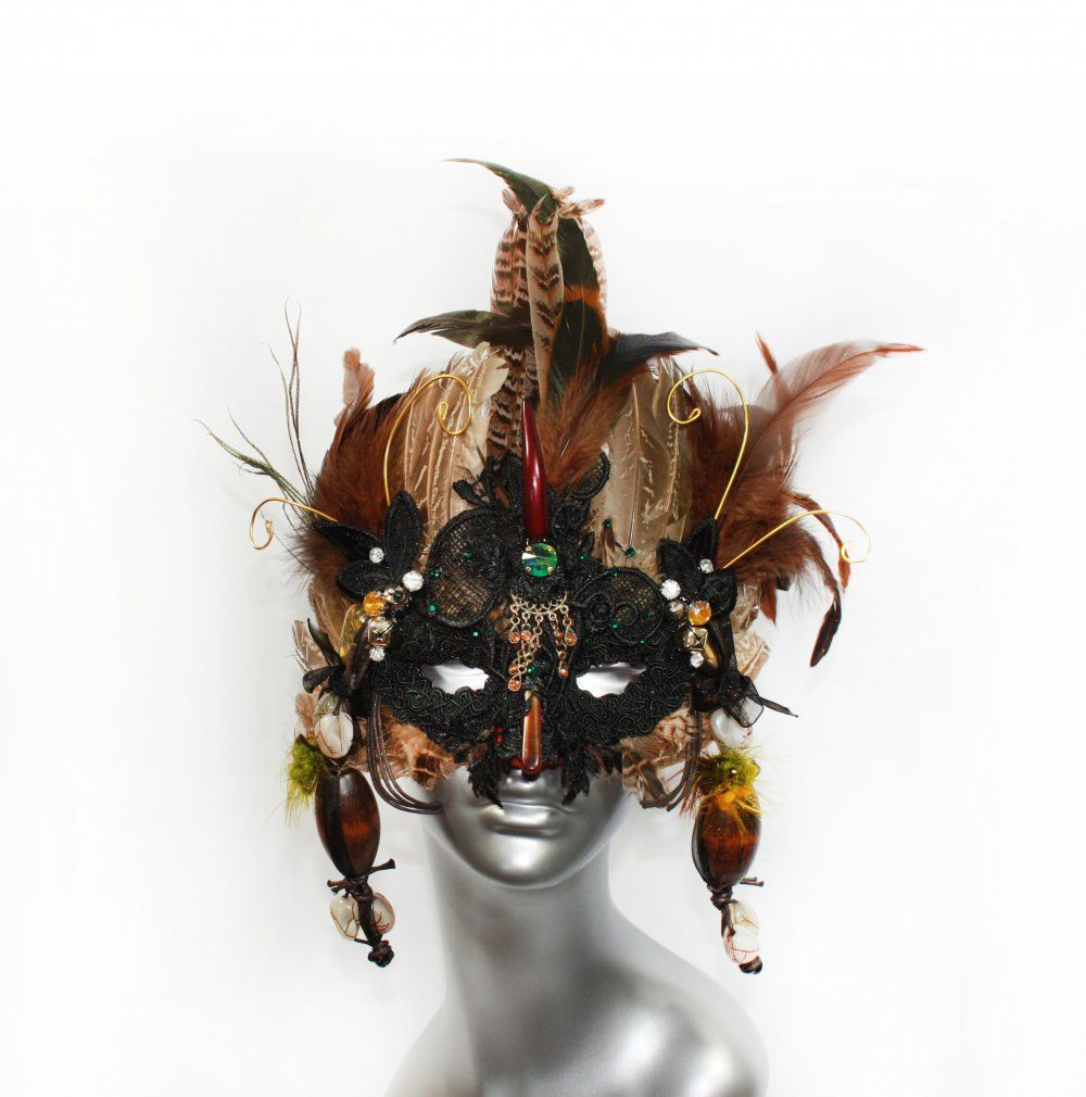 I present you this unique feathers African mask, tribal masquerade ...