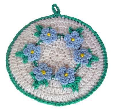 """Pretty free crochet pattern; """" Forget Me Nots"""" hot pad, trivet, potholder. Many Free Patterns on this site."""