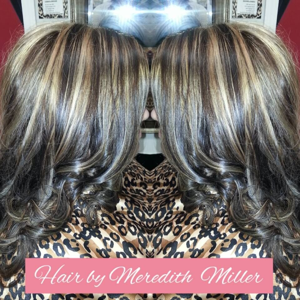 Dark golden brown with thicker blonde highlights done by meredith