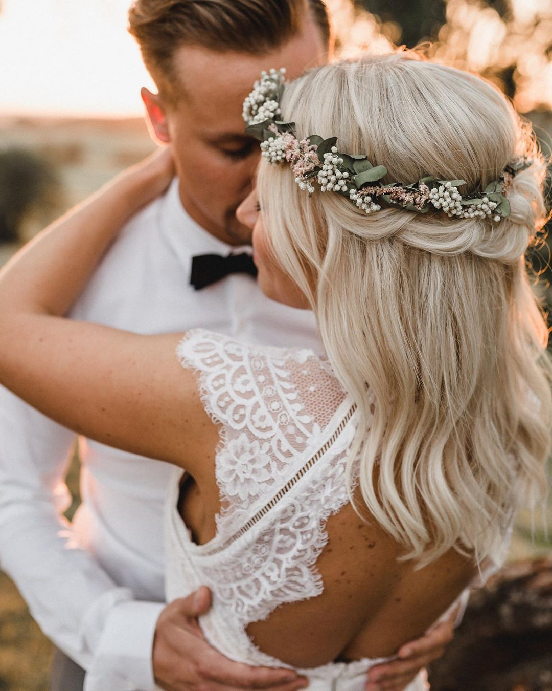 Photo of Braided hair flower wreaths backless wedding dresses couples in love wi